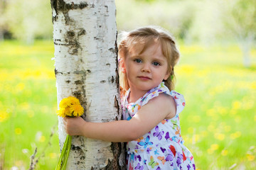 little smiling girl near birch