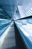 perspective view of business escalator indoor airport poster