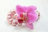 Phalaenopsis orchid and pearl necklace
