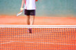 A tennis player walking out of a tennis court