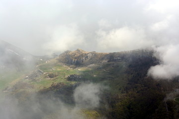 View on peaks and valleys under coulds