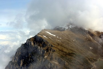 View on one of italian peaks Monte Baldo in clouds