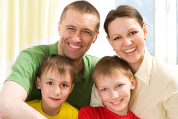 portrait of a happy family playing on a light