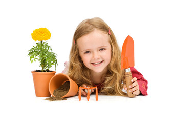 Happy little girl with gardening utensils