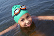 Preteen girl swimming in sea