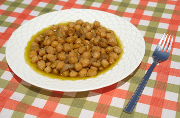 Cooked chickpeas and a fork