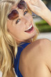 Beautiful Laughing Blond Woman In Heart Shaped Sunglasses