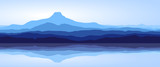 Fototapety View of blue mountains with reflection in lake - panorama