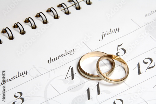 Couple of Wedding Rings on Calender - 23154978