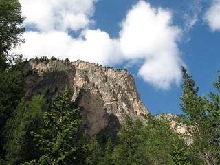 Stevia's summit under a limpid sky in Selva Gardena