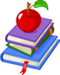 Pile book with red apple