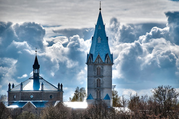 beautiful church with cloudy sky in background