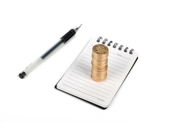coins and notebook