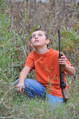 Young hunter looking up