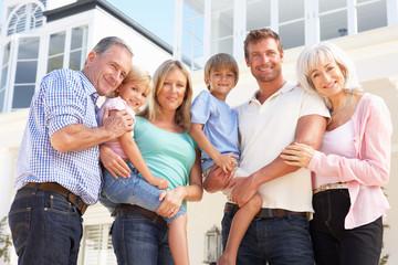 Extended Family Outside Modern House