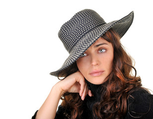 Gorgeous fashion model wearing a hat isolated on white.
