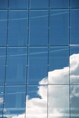 white cloud reflection in a skyscraper