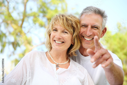 Close-up portrait of a mature couple smiling.