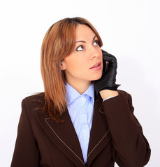 Modern confident woman talking on the cell phone