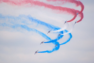 Formation of Alpha Jets performing turn with colored smokes