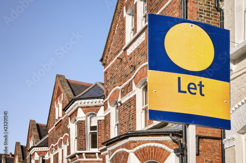 """A typical red-brick townhouse with """" Let"""" sign , London."""