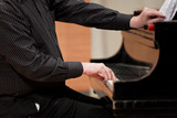 Hands of piano player during performance