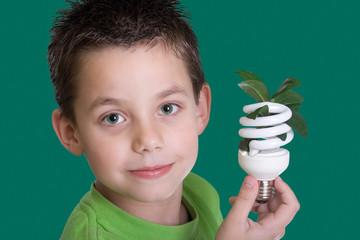 Kid with energy saving bulb