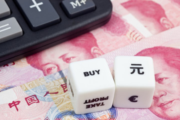 Chinese currency with calculator and dice