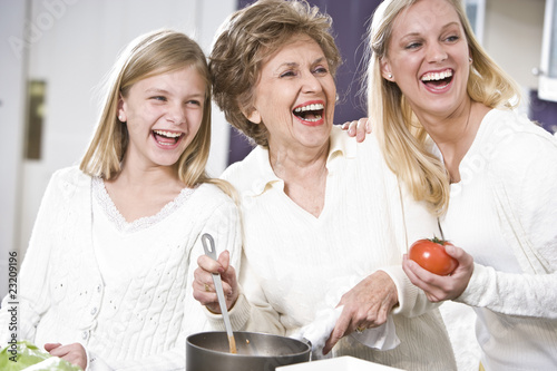 Grandmother with family laughing in kitchen