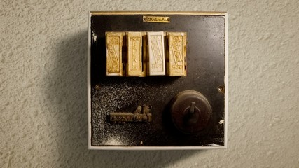 A old-style fuse box. The Switch flicks up and down.
