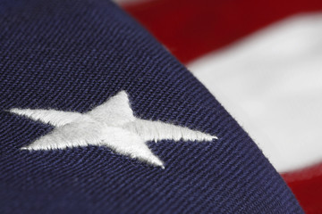 american flag with an embroided star