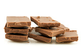 pile of milk chocolate blocks,isolated on white background