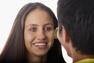 beautiful young woman talking to a man