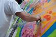 Graffitist Applying Spray Paint