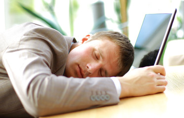 portrait of sleeping businessman in an office