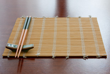 Chopsticks on mat