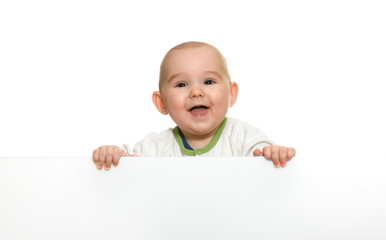 cute baby boy holding empty blank board