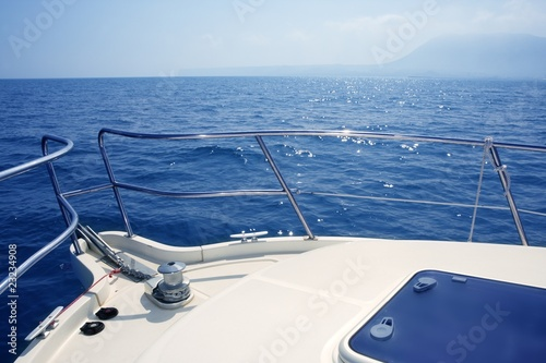 Leinwanddruck Bild boat bow sailing sea with anchor chain winch