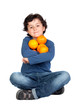 Funny child with many oranges