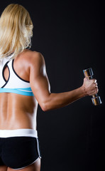 Woman holding a dumbbells