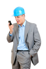 engineer with blue hard hat talking on cell phone