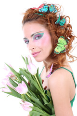 Red-haired woman with flowers and butterflies on her head