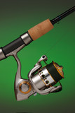 spinning reel attached to a cork handled fishing pole