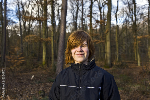 smiling boy in the forest