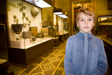 boy at excursion in historical museum