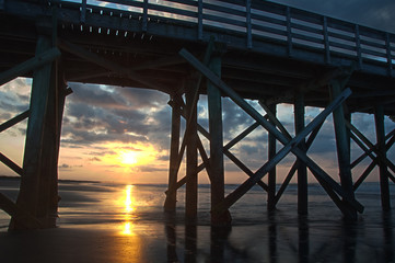 Sunrise Through Pier Columns