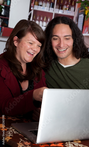 Couple with Laptop Laughing