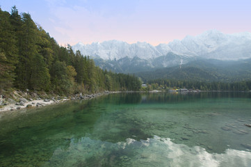 The Zugspitze massive in the german Alps and the Eibsee