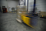 Fork lift driving fast with cargo