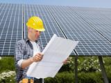 electrician standing near solar panels